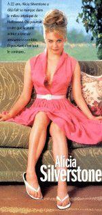 сексуальная блондинка Алисия Сильверстоун в коротком розовом платице