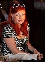 Наталья Бочкарева в платье с декольте
