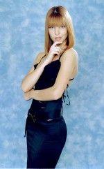 Наталья Подольская в строгом но сексуальном черном платье